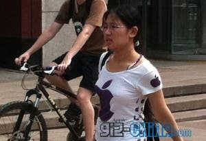 woman in china wearing apple tshirt