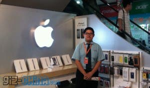 happy guy in fake apple store